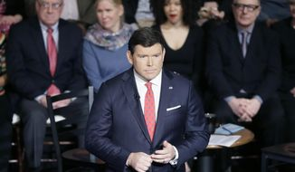 """FILE - In this March 7, 2016 file photo, FOX News town hall host Bret Baier talks to the crowd before the town hall with Democratic presidential candidates, Sen. Bernie Sanders, I-Vt, and Hillary Clinton at the Gem Theatre, in Detroit. Baier and his family have survived a motor vehicle crash in Montana.  In a statement released Tuesday, Jan. 22, 2019, the anchor and executive editor of Fox News Channel's """"Special Report"""" says after a weekend of skiing, he was driving to the airport on icy roads with his wife and their two sons on Monday morning when they were """"involved in a major car crash.""""  (AP Photo/Carlos Osorio, File)"""