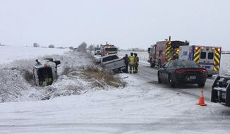"""This Monday, Jan. 21, 2019, photo provided by the Montana Department of Justice shows the vehicle Fox News host Bret Baier and his family were riding in that overturned outside Bozeman, Montana. In a statement released Tuesday, the anchor and executive editor of Fox News Channel's """"Special Report"""" says that after a weekend of skiing he was driving to the airport on icy roads with his wife and their two sons on Monday morning when they were """"involved in a major car crash"""" in Bozeman. Baier and his family survived the crash and is expected to be back on the air Tuesday night. (Montana Department of Justice via AP)"""