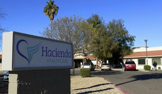 This Friday, Jan. 4, 2019, file photo shows Hacienda HealthCare in Phoenix. Two doctors who cared for an incapacitated woman who gave birth as a result of a sexual assault are no longer providing medical services at the long-term care center in Phoenix, Hacienda HealthCare said Sunday, Jan. 20. (AP Photo/Ross D. Franklin, File)