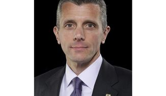 This undated photo provided by Cigna shows David Cordani, President and Chief Executive Officer of Cigna. Cordani spoke recently with The Associated Press during an interview. (Thaddeaus Harden Photography/Cigna via AP)