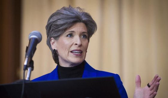 In this Dec. 11, 2018, file photo, Sen. Joni Ernst, R-Iowa, speaks during the signing of an order withdrawing federal protections for countless waterways and wetlands, at EPA headquarters in Washington. (AP Photo/Cliff Owen, File) **FILE**
