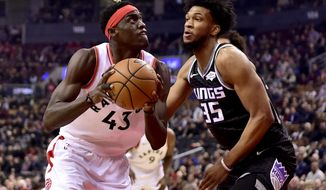 Toronto Raptors forward Pascal Siakam (43) looks for the shot as Sacramento Kings forward Marvin Bagley III (35) defends during first half NBA basketball action in Toronto on Tuesday, Jan. 22, 2019. (Frank Gunn/The Canadian Press via AP)