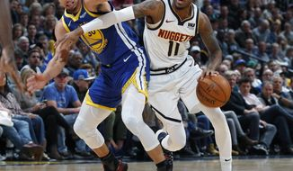 FILE--In this Tuesday, Jan. 15, 2019, file photograph, Denver Nuggets guard Monte Morris, right, drives past Golden State Warriors guard Stephen Curry in the second half of an NBA basketball game Tuesday, Jan. 15, 2019, in Denver. (AP Photo/David Zalubowski, File)