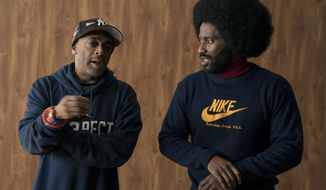 "This image released by Focus features shows director Spike Lee, left, and actor John David Washington on the set of ""BlacKkKlansma."" Lee was nominated for an Oscar award for best director for his film, ""BlacKkKlansman."" The film was also nominated for best picture. (David Lee/Focus Features via AP)"