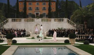 Models wear creations for the Chanel Spring/Summer 2019 Haute Couture fashion collection presented in Paris, Tuesday Jan. 22, 2019. (AP Photo/Christophe Ena)