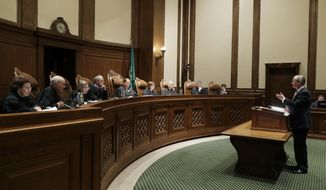 Lawrence Lessig, right, an attorney representing three Washington state presidential electors, speaks Tuesday, Jan. 22, 2019, during a Washington Supreme Court hearing in Olympia, Wash., on a lawsuit addressing the constitutional freedom of electors to vote for any candidate for president, not just the nominee of their party. (AP Photo/Ted S. Warren)