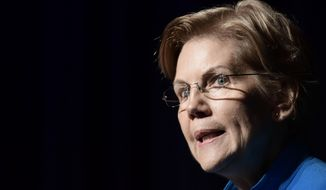 """Elizabeth Warren, United States senator from Massachusetts and one of the many Democrats running for president in 2020, speaks at the """"Community Conversation about Puerto Rico and its Recovery"""" held at the Alejandro Tapia y Rivera Theater, in San Juan, Puerto Rico, Tuesday Jan. 22, 2019. Warren addressed the hardships Puerto Rico has endured in the past two years, particularly its debt crisis and the recovery in the aftermath of Hurricane Maria. (AP Photo/Carlos Giusti) **FILE**"""