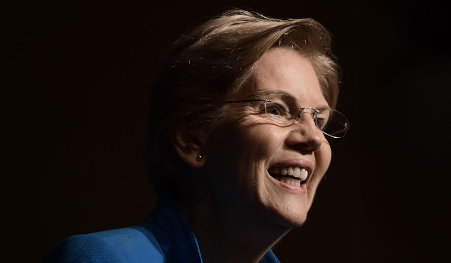 """Elizabeth Warren, United States senator from Massachusetts and one of the many Democrats running for president in 2020, speaks at the """"Community Conversation about Puerto Rico and its Recovery"""" held at the Alejandro Tapia y Rivera Theater, in San Juan, Puerto Rico, Tuesday Jan. 22, 2019. Warren addressed the hardships Puerto Rico has endured in the past two years, particularly its debt crisis and the recovery in the aftermath of Hurricane Maria. (AP Photo/Carlos Giusti)"""