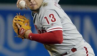 File-This Aug. 7, 2018, file photo shows Philadelphia Phillies second baseman Asdrubal Cabrera (13) in the first inning of a baseball game against the Arizona Diamondbacks in Phoenix. A person familiar with the deal says free agent infielder Cabrera has reached an agreement on a $3.5 million, one-year contract with the Texas Rangers. The person spoke to The Associated Press on condition of anonymity Tuesday, Jan. 22, 2019, because the deal is pending a physical for the 33-year-old Cabrera, who split last season with the New York Mets and Philadelphia Phillies.(AP Photo/Rick Scuteri, File)