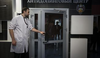 "FILE - In this Tuesday, May 24, 2016 file photo, Grigory Dudko opens a door for journalists during a visit to Russia's national drug-testing laboratory in Moscow, Russia. Vladimir Putin's spokesman says Russia is ""optimistic"" ahead of a World Anti-Doping Agency ruling Tuesday Jan. 22, 2019, on whether the country's authorities met demands to turn over lab data. The WADA executive committee reinstated Russia's anti-doping agency in September 2018 on condition the country turned over data from a Moscow laboratory. (AP Photo/Alexander Zemlianichenko, File)"