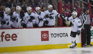 San Jose Sharks center Joe Pavelski (8) celebrates his goal with his teammates in the first period of an NHL hockey game Washington Capitals, Tuesday, Jan. 22, 2019, in Washington. (AP Photo/Alex Brandon)