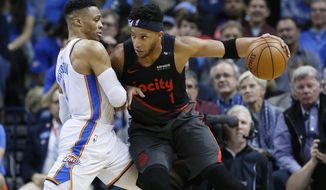 Portland Trail Blazers guard Evan Turner (1) drives against Oklahoma City Thunder guard Russell Westbrook, left, in the first half of an NBA basketball game in Oklahoma City, Tuesday, Jan. 22, 2019. (AP Photo/Sue Ogrocki)