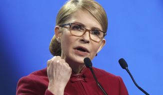 Former Ukrainian Prime Minister Yulia Tymoshenko addresses supporters during campaign rally in Kiev, Ukraine, Tuesday, Jan. 22, 2019. Tymoshenko has announced her presidential bid. Opinion polls have placed the 58-year-old, who was the country's prime minister between 2007 and 2010, as a front-runner in the presidential election set for March 31. (AP Photo/Efrem Lukatsky)