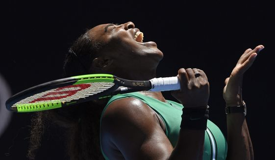 United States' Serena Williams reacts after losing a point to Karolina Pliskova of the Czech Republic during their quarterfinal match at the Australian Open tennis championships in Melbourne, Australia, Wednesday, Jan. 23, 2019. (AP Photo/Andy Brownbill)