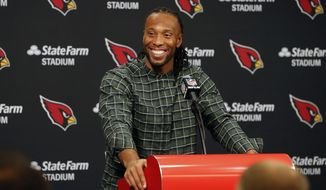 """In this Dec. 23, 2018, file photo, Arizona Cardinals wide receiver Larry Fitzgerald speaks after an NFL football game against the Los Angeles Rams, in Glendale, Ariz. Star receiver Larry Fitzgerald is returning to the Arizona Cardinals for a 16th NFL season. The Cardinals announced Wednesday, Jan. 23, 2019, that they signed the 35-year-old Fitzgerald to a one-year contract. Team president Michael Bidwell says, """"No player has meant more to this franchise or this community than Larry Fitzgerald."""" (AP Photo/Rick Scuteri) **FILE**"""