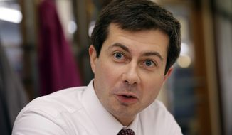 In this Jan. 10, 2019, file photo, South Bend, Ind. Mayor Pete Buttigieg, talks with an AP reporter at Farmers Market in South Bend, Ind.  (AP Photo/Nam Y. Huh)