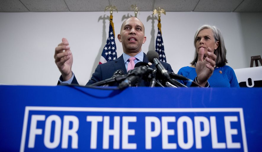 Democratic Caucus Chairman Rep. Hakeem Jeffries of N.Y., accompanied by Democratic Caucus Vice Chair Katherine Clark, D-Mass., right, speaks at a news conference following a House Democratic Caucus meeting on Capitol Hill in Washington, Wednesday, Jan. 23, 2019. (AP Photo/Andrew Harnik)