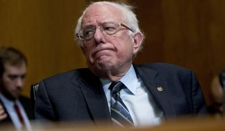 Sen. Bernie Sanders, I-Vt., reacts during a hearing on Capitol Hill in Washington, in this Jan. 16, 2019, photo.  Medicare-for-all makes a good first impression, but support plunges when people are asked if theyd pay higher taxes or put up with treatment delays to get it. The survey, released Wednesday, Jan. 23, by the nonpartisan Kaiser Family Foundation, comes as Democratic presidential hopefuls embrace the idea of a government-run health care system, considered outside the mainstream of their party until Sanders made it the cornerstone of his 2016 campaign. (AP Photo/Andrew Harnik) ** FILE **