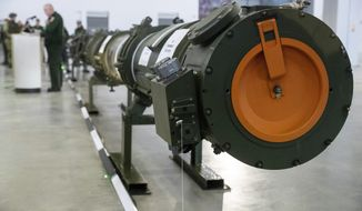 The 9M729 land-based cruise missile in Kubinka outside Moscow, Russia, Wednesday, Jan. 23, 2019. The Russian military on Wednesday rolled out its new missile and spelled out its specifications, seeking to dispel the U.S. claim that the weapon violates a key nuclear arms pact. (AP Photo/Pavel Golovkin)