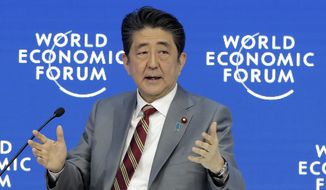 Japanese Prime Minister Shinzo Abe addresses the annual meeting of the World Economic Forum in Davos, Switzerland, Wednesday, Jan. 23, 2019. (AP Photo/Markus Schreiber)