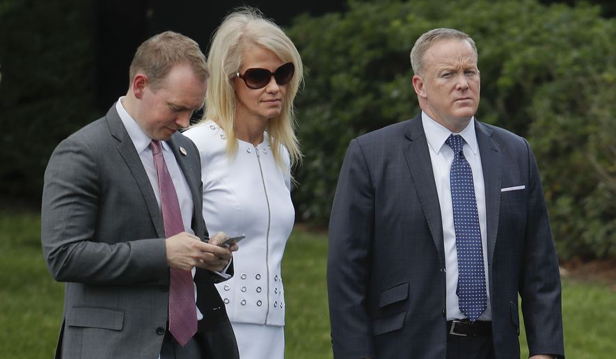 Cliff Sims, left, director of White House Message Strategy, stands with Kellyanne Conway, center, senior adviser to President Donald Trump, and White House press secretary Sean Spicer, right, as they listen to President Donald Trump welcome the 2016 NCAA Football National Champions Clemson University Tigers, Monday, June 12, 2017, during a ceremony on the South Lawn of the White House in Washington. (AP Photo/Pablo Martinez Monsivais) ** FILE **