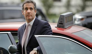 FILE - In this Sept. 19, 2017, file photo, Michael Cohen, President Donald Trump's personal attorney, steps out of a cab during his arrival on Capitol Hill in Washington. Cohen won't appear as scheduled before the House Oversight and Reform Committee on Feb. 7, 2019. Cohen's adviser Lanny Davis says the delay is on the advice of Cohen's lawyers because Cohen's still cooperating in special counsel Robert Mueller's Russia investigation. (AP Photo/Pablo Martinez Monsivais, file)