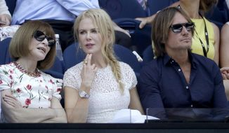 Australian actor Nicole Kidman, center, sits with her husband Keith Urban, right, as she chats with Anna Wintour, ahead of the semifinal between Petra Kvitova of the Czech Republic and United States' Danielle Collins at the Australian Open tennis championships in Melbourne, Australia, Thursday, Jan. 24, 2019.