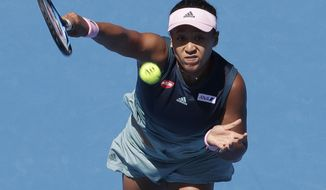 Japan's Naomi Osaka makes a forehand return to Ukraine's Elina Svitolina during their quarterfinal match at the Australian Open tennis championships in Melbourne, Australia, Wednesday, Jan. 23, 2019. (AP Photo/Aaron Favila)