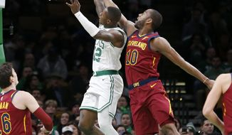 Boston Celtics guard Terry Rozier (12) drives to the basket ahead of Cleveland Cavaliers guard Alec Burks (10) during the first half of an NBA basketball game, Wednesday, Jan. 23, 2019, in Boston. (AP Photo/Mary Schwalm)