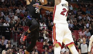 Los Angeles Clippers forward Tobias Harris is fouled by Miami Heat center Hassan Whiteside during the first half of an NBA basketball game, Wednesday, Jan. 23, 2019, in Miami. (AP Photo/Brynn Anderson)