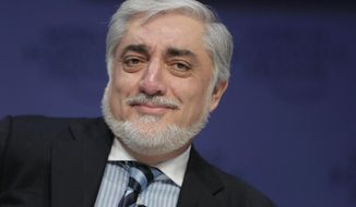 """FILE - In this Tuesday, Jan. 22, 2019 file photo, Abdullah Abdullah, Chief Executive Officer of the Islamic Republic of Afghanistan, participates in a session at the annual meeting of the World Economic Forum in Davos, Switzerland. Afghanistan's chief executive, Abdullah Abdullah, urged the world not to give up on his impoverished country, which has struggled with corruption, political instability and a long Taliban insurgency. He told The Associated Press in an interview Wednesday, Jan. 23 at the World Economic Forum in Davos, Switzerland: """"Don't lose patience. (AP Photo/Markus Schreiber, file)"""