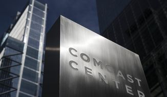 FILE- This May 21, 2018, file photo shows a sign outside the Comcast Center in Philadelphia. Comcast Corp. reports financial results Wednesday, Jan. 23, 2019. (AP Photo/Matt Rourke, File)