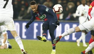 PSG's Neymar tries to score during the French Cup soccer match between Paris Saint Germain and Strasbourg at the Parc des Princes stadium in Paris, Wednesday, Jan. 23, 2019. (AP Photo/Michel Euler)