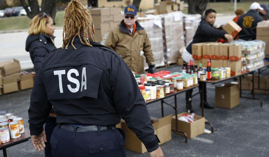 TSA employee Princess Young visits a food pantry for furloughed government workers affected by the federal shutdown, Wednesday, Jan. 23, 2019, in Baltimore. (AP Photo/Patrick Semansky)
