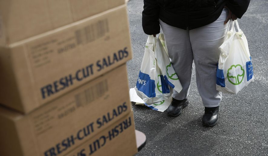 Therese Easley, an FDA contract worker, collects food and supplies from a food pantry for furloughed government workers affected by the federal shutdown, Wednesday, Jan. 23, 2019, in Baltimore. (AP Photo/Patrick Semansky)