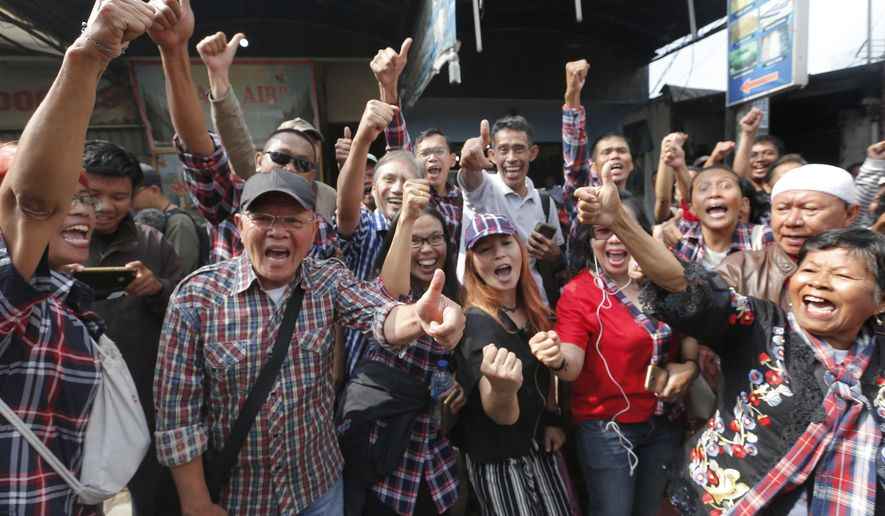 """Supporters of former Jakarta Gov. Basuki """"Ahok"""" Tjahaja Purnama, react outside a police prison in Depok, Indonesia, Thursday, Jan. 24, 2019. A polarizing Christian politician whose campaign comments ignited protests that were the largest in Muslim-majority Indonesia in years was freed Thursday after serving nearly two years in prison for blasphemy. (AP Photo/Tatan Syuflana)"""