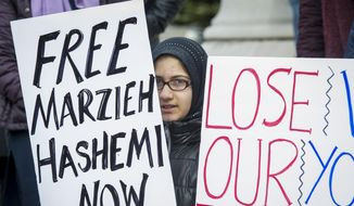 Supporters of Marzieh Hashemi, an American-born anchor for Iran's state television broadcaster, demonstrate outside the Federal Courthouse where Hashemi will appear before a U.S. grand jury, Wednesday, Jan. 23, 2019, in Washington.  She is in custody as a material witness. (AP Photo/Cliff Owen)