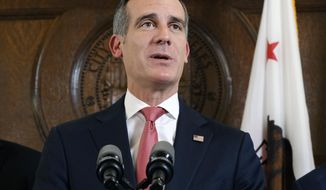 """FILE - In this Tuesday, Jan. 22, 2019 file photo Los Angeles Mayor Eric Garcetti, talks during a news conference at City Hall in downtown Los Angeles. While Washington remains hobbled by a shutdown and deep partisanship, Garcetti says the resolution of a teachers strike shows that government can bridge divides and bring improvements to schools. """"It's a national model for what we can do,"""" says Garcetti, who plans to soon decide if he will enter the 2020 White House contest. (AP Photo/Richard Vogel, File)"""