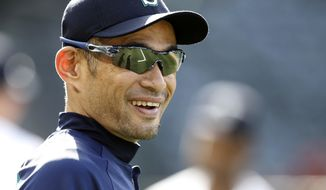 FILE - In this Tuesday, July 10, 2018 file photo, Seattle Mariners' Ichiro Suzuki, of Japan, smiles during warm ups before a baseball game against the Los Angeles Angels in Anaheim, Calif. Ichiro Suzuki has agreed to a minor-league deal with the Seattle Mariners paving the way for the 45-year-old to play in Seattle's season-opening series in Japan. Suzuki's agent, John Boggs, confirmed the agreement on Wednesday, Jan. 23, 2019. (AP Photo/Alex Gallardo, File)