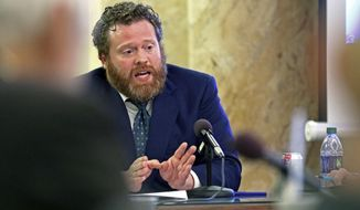 Drew Snyder, executive director of the Mississippi Division of Medicaid, gives an agency update to members of the House Medicaid Committee at the Capitol in Jackson, Miss., Wednesday, Jan. 23, 2019. (AP Photo/Rogelio V. Solis)