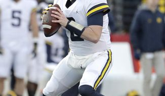 FILE - In this Nov. 10, 2018, file photo, Michigan quarterback Shea Patterson looks to pass against Rutgers during the first half of an NCAA college football game, in Piscataway, N.J. The NCAA quietly made a big change last year that helped quarterback Shea Patterson play for Michigan and will determine whether Justin Fields is eligible this fall at Ohio State.(AP Photo/Julio Cortez, File)