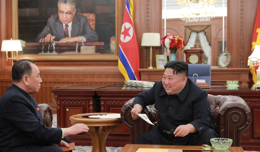 """In this Wednesday, Jan. 23, 2019, photo provided on Thursday, Jan. 24, 2019, by the North Korean government, North Korean leader Kim Jong-un, right, meets Kim Yong-chol, who traveled to Washington to discuss denuclearization talks, in Pyongyang. The content of this image is as provided and cannot be independently verified. Korean language watermark on image as provided by source reads: """"KCNA"""" which is the abbreviation for Korean Central News Agency. (Korean Central News Agency/Korea News Service via AP)"""