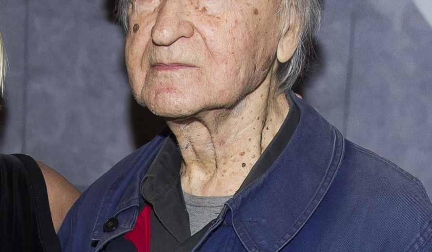 FILE - In this Nov. 19, 2014 file photo, Lithuanian-born director Jonas Mekas attend the Whitney Museum Gala in New York. Mekas, 96, who survived a Nazi labor camp and years as a refugee, died Wednesday, Jan. 23, 2019, at his home, according to the Anthology of Film Archives. He was artistic director of the New York center for film preservation, a leading avant-garde movie theater.  (Photo by Charles Sykes/Invision/AP, File)
