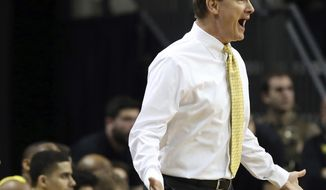 FILE - In this Jan. 13, 2019, file photo, Oregon head men's basketball coach Dana Altman calls to his team during the first half of an NCAA college basketball game against Southern California,in Eugene, Ore. The once-proud Oregon Ducks have fallen to 2-3 in Pac-12 play and eighth in the conference standings, and their shot at making the NCAA Tournament field seems to be rapidly  slipping away. But they could boost their season on Thursday with a victory over Washington, the last undefeated league team at 5-0. (AP Photo/Chris Pietsch, File)