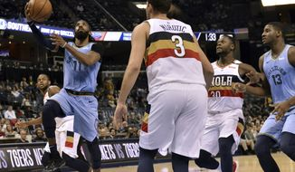 Memphis Grizzlies guard Mike Conley (11) shoots ahead of New Orleans Pelicans forward Nikola Mirotic (3) in the second half of an NBA basketball game Monday, Jan. 21, 2019, in Memphis, Tenn. (AP Photo/Brandon Dill)