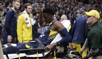 Indiana Pacers guard Victor Oladipo is taken off the court on a stretcher after he was injured during the first half of the team's NBA basketball game against the Toronto Raptors in Indianapolis, Wednesday, Jan. 23, 2019. (AP Photo/Michael Conroy)