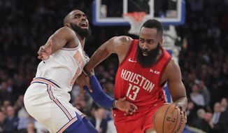 Houston Rockets' James Harden (13) drives past New York Knicks' Tim Hardaway Jr. (3) during the first half of an NBA basketball game Wednesday, Jan. 23, 2019, in New York. (AP Photo/Frank Franklin II)