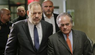 FILE- In this Dec. 20, 2018 file photo, Harvey Weinstein, left, arrives at New York Supreme Court with his attorney Benjamin Brafman in New York. Brafman filed court papers on Thursday, Jan. 17, 2019, asking to withdraw as Weinstein's lawyer. The high-profile criminal defense lawyer is leaving the movie producer's rape case weeks after failing to get the charges dismissed. (AP Photo/Seth Wenig, File)