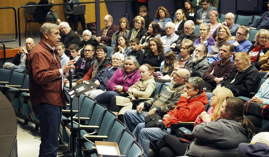 FILE - In this Monday, Jan. 21, 2019, file photo, provided by Zoe Selsky, U.S. Sen. Jeff Merkley holds a town hall at Chemeketa Community College in Salem, Ore. With the federal government shutdown in its second month, officials in Oregon are looking to help with almost 10,000 federal employees in the state going unpaid, with food stamps for many more at risk, and with huge swaths of federal lands going unattended. Merkley says if aid is provided, he'll seek reimbursement from Washington. (Zoe Selsky via AP, File)