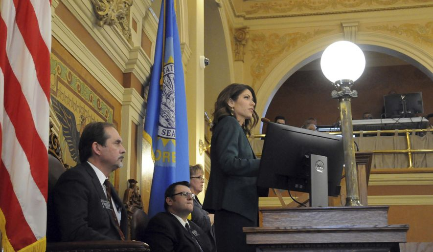 Gov. Kristi Noem gives her first budget address to lawmakers at the state Capitol in Pierre, S.D., Wednesday, Jan. 23, 2019. Noem is proposing spending hikes for education, state employees and Medicaid providers. (AP Photo/James Nord)